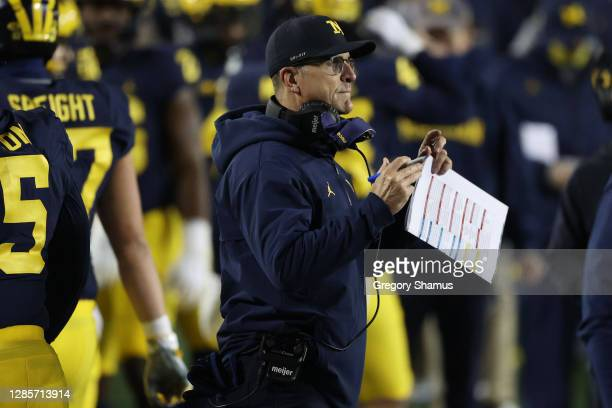 Head coach Jim Harbaugh looks on while playing the Wisconsin Badgers at Michigan Stadium on November 14, 2020 in Ann Arbor, Michigan.