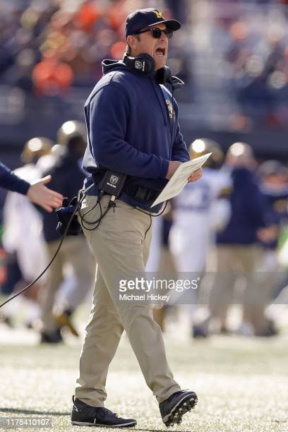 Head coach Jim Harbaugh of the Michigan Wolverines is seen during the first half against the Illinois Fighting Illini at Memorial Stadium on October...