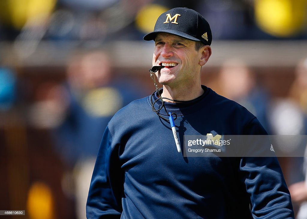 Head coach Jim Harbaugh of the Michigan Wolverines looks on during the Michigan Football Spring Game on April 4, 2015 at Michigan Stadium in Ann Arbor, Michigan.