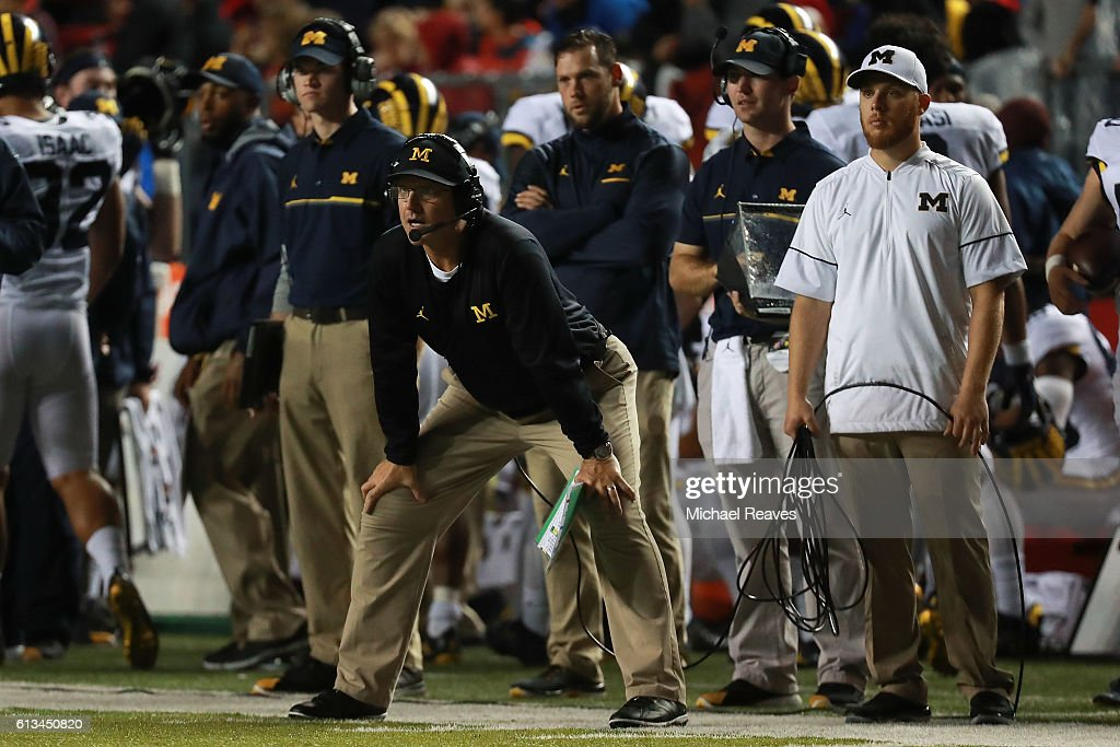 Head coach Jim Harbaugh of the Michigan Wolverines looks on from the sideline during the game against the Rutgers Scarlet Knights at High Point Solutions Stadium on October 8, 2016 in Piscataway, New Jersey.