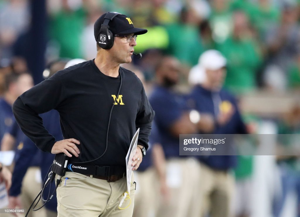 9cb75d320 Head coach Jim Harbaugh of the Michigan Wolverines looks on in the ...