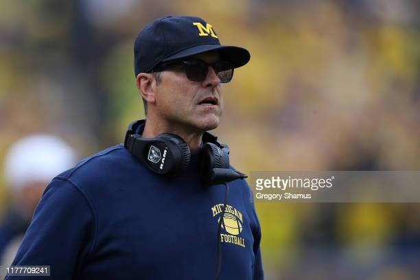 Head coach Jim Harbaugh of the Michigan Wolverines looks on in the second half while playing the Rutgers Scarlet Knights at Michigan Stadium on...
