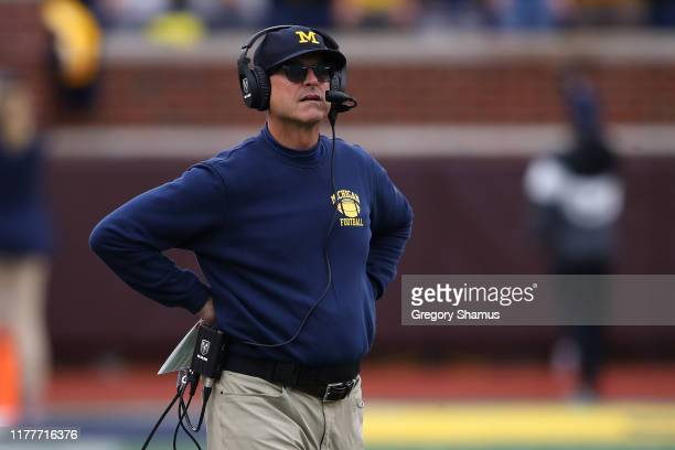 Head coach Jim Harbaugh of the Michigan Wolverines looks on in the first half while playing the Rutgers Scarlet Knights at Michigan Stadium on...