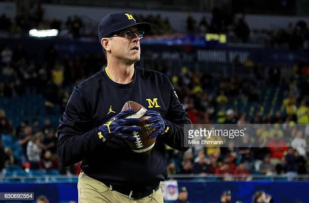 Head coach Jim Harbaugh of the Michigan Wolverines looks on prior to their Capitol One Orange Bowl game against the Florida State Seminoles at Sun...