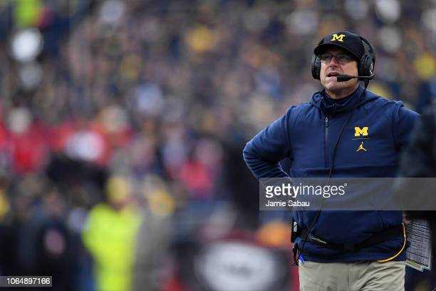 Head Coach Jim Harbaugh of the Michigan Wolverines looks up at the scoreboard in the third quarter after the Ohio State Buckeyes scored at Ohio...
