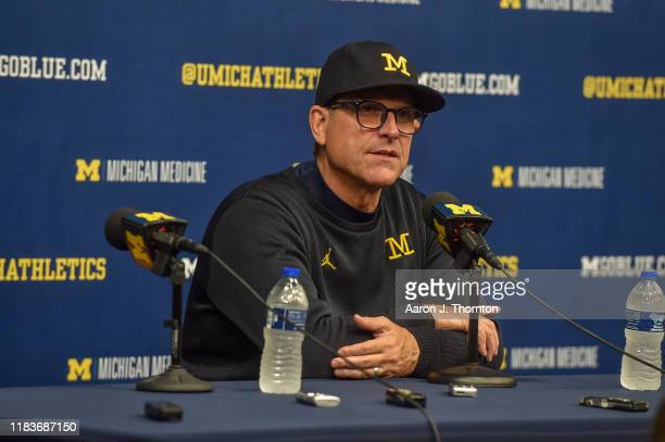 Head Coach Jim Harbaugh of the Michigan Wolverines speaks at the after game press conference at a college football game against the Notre Dame...