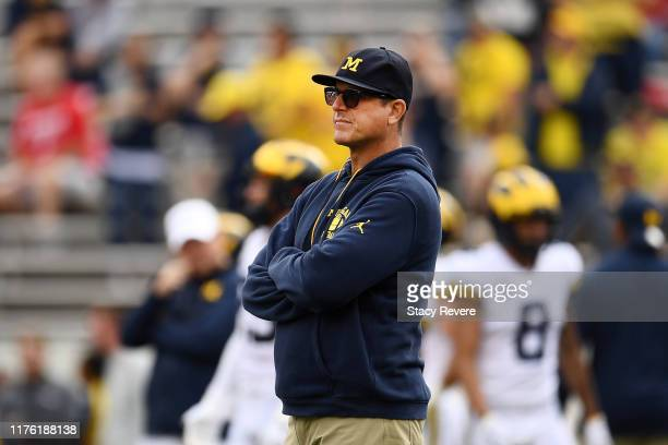 Head coach Jim Harbaugh of the Michigan Wolverines watches action prior to a game against the Wisconsin Badgers at Camp Randall Stadium on September...