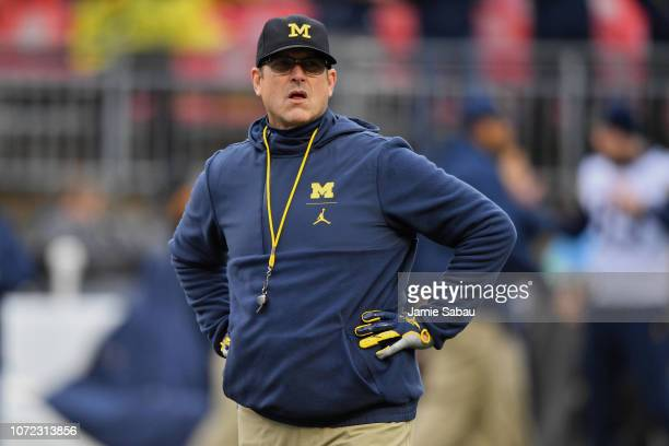 Head Coach Jim Harbaugh of the Michigan Wolverines watches his team warm up before a game against the Ohio State Buckeyes at Ohio Stadium on November...