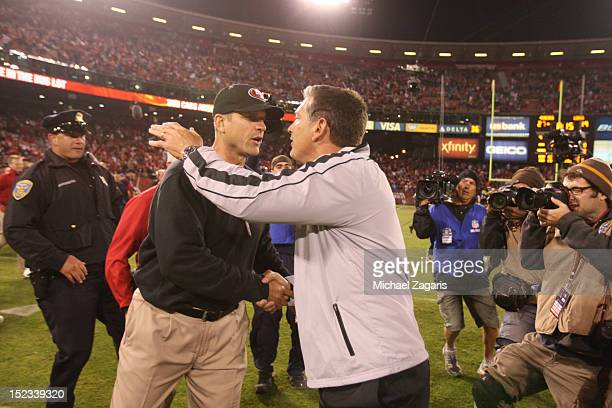 Head Coach Jim Harbaugh of the San Francisco 49ers and Head Coach Jim Schwartz of the Detroit Lions shake hands following the game at Candlestick...