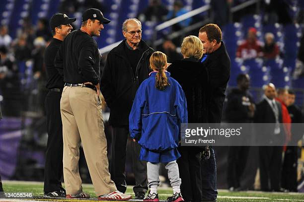 Head coach Jim Harbaugh of the San Francisco 49ers and his brother head coach John Harbaugh of the Baltimore Ravens talk with their parents Jack and...