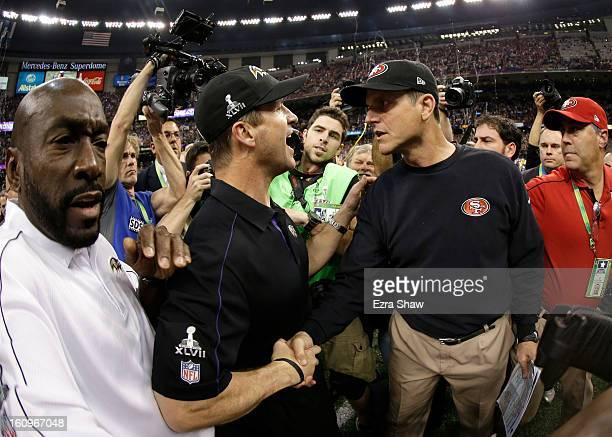 Head coach Jim Harbaugh of the San Francisco 49ers congratulates his brother head coach John Harbaugh of the Baltimore Ravens after the Ravens won...