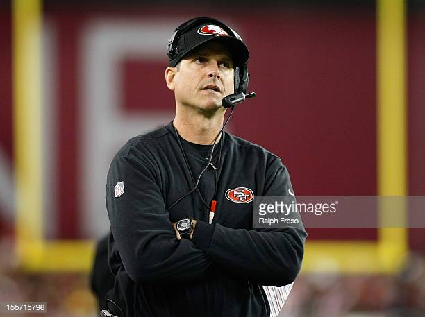 Head coach Jim Harbaugh of the San Francisco 49ers looks on from the sideline during action in an NFL game against the Arizona Cardinals at...