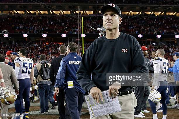 Head coach Jim Harbaugh of the San Francisco 49ers runs off the field after the 49ers lose 38-35 in overtime to the San Diego Chargers at Levi's...