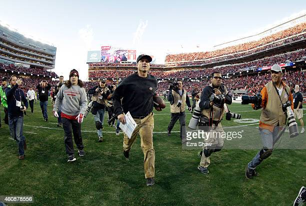 Head coach Jim Harbaugh of the San Francisco 49ers runs off the field after their game against the Arizona Cardinals at Levi's Stadium on December 28...