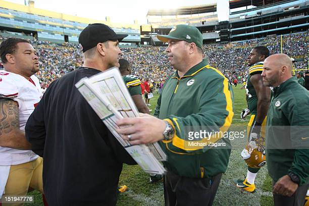 Head Coach Jim Harbaugh of the San Francisco 49ers shakes hands with Head Coach Mike Mccarthy of the Green Bay Packers following the game at Lambeau...