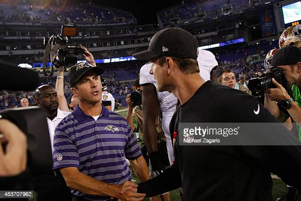 Head Coach Jim Harbaugh of the San Francisco 49ers shakes hands with his brother John Harbaugh head coach of the Baltimore Ravens on the field...