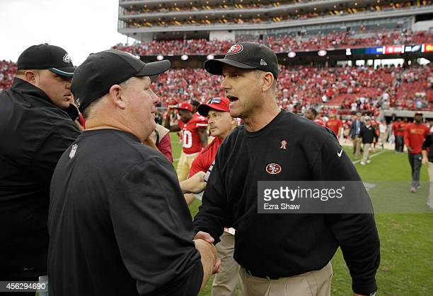Head coach Jim Harbaugh of the San Francisco 49ers shakes hands with head coach Chip Kelly of the Philadelphia Eagles after the 49ers beat the Eagles...
