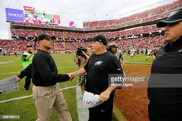 Head Coach Jim Harbaugh of the San Francisco 49ers shakes hands with Head Coach Chip Kelly of the Philadelphia Eagles following the game at Levi...
