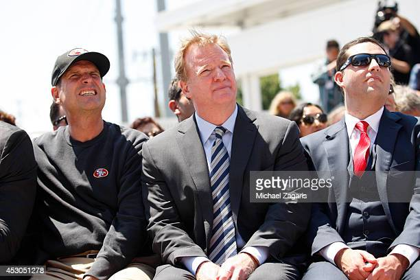 Head Coach Jim Harbaugh of the San Francisco 49ers sits with NFL Commissioner Roger Goodell and 49ers CEO Jed York during the the Ribbon Cutting...