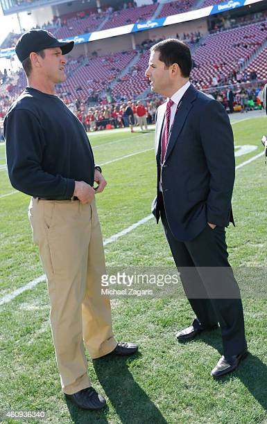 Head Coach Jim Harbaugh of the San Francisco 49ers talks with CEO Jed York on the field prior to the game against the Arizona Cardinals at Levi...