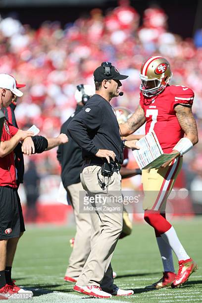 Head Coach Jim Harbaugh of the San Francisco 49ers talks with Colin Kaepernick during the game against the New York Giants at Candlestick Park on...