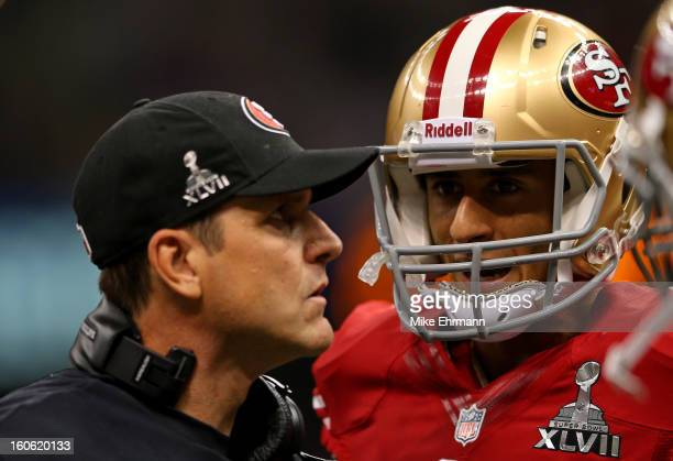 Head coach Jim Harbaugh of the San Francisco 49ers talks with Colin Kaepernick of the San Francisco 49ers during Super Bowl XLVII against the...