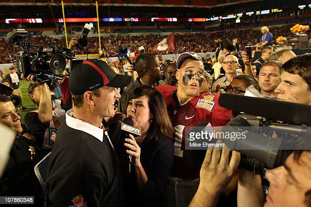 Head coach Jim Harbaugh of the Stanford Cardinal is interviewed by ESPN's Michelle Tafoya after Stanford won 4012 against the Virginia Tech Hokies...