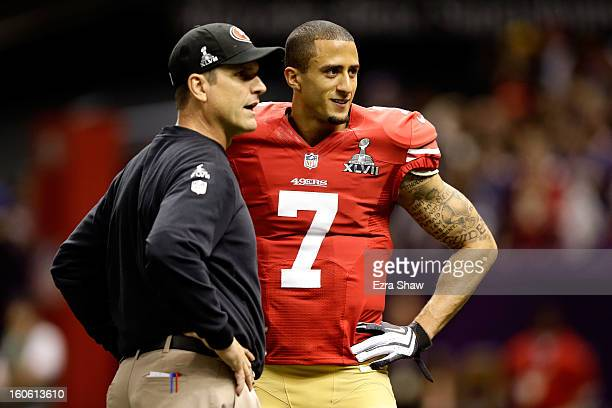 Head coach Jim Harbaugh speaks to Colin Kaepernick of the San Francisco 49ers during warm ups prior to Super Bowl XLVII against the Baltimore Ravens...