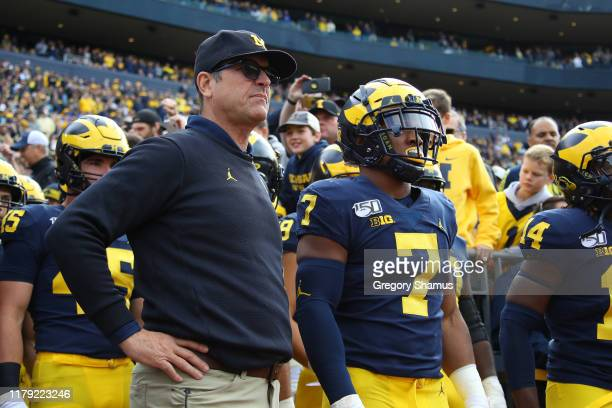 Head coach Jim Harbaugh waits to take the field to play the Iowa Hawkeyes at Michigan Stadium on October 05, 2019 in Ann Arbor, Michigan. Michigan...
