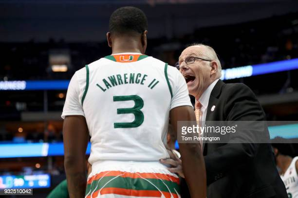 Head coach Jim Larranaga of the Miami Hurricanes talks with Anthony Lawrence II in the first half while taking on the Loyola Ramblers in the first...