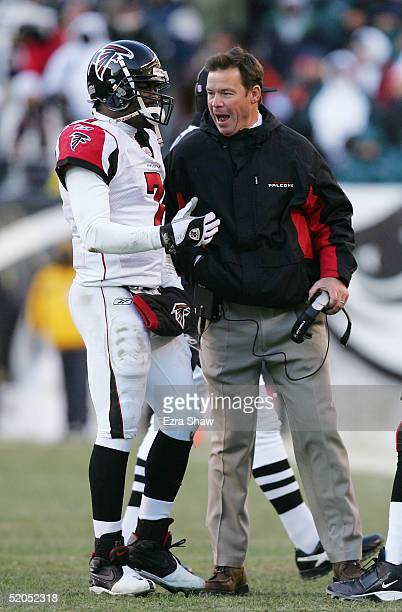 Head coach Jim Mora Jr. Shouts at his quarterback Michael Vick of the Atlanta Falcons in the first quarter during the NFC Championship game against...