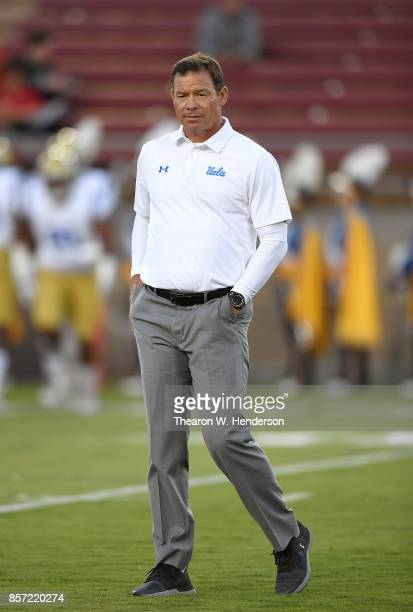 Head coach Jim Mora of the UCLA Bruins looks on while his team warms up prior to playing the Stanford Cardinal in a NCAA football game at Stanford...
