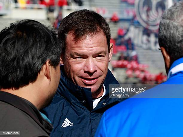 Head coach Jim Mora of the UCLA Bruins talks to boosters before a game against the Utah Utes at a college football game at Rice Eccles Stadium on...