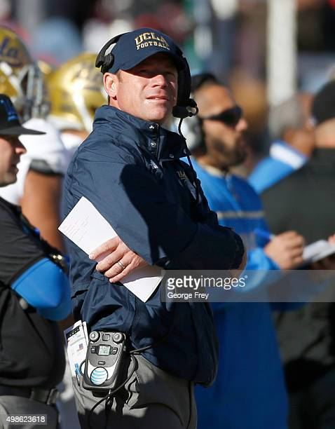 Head coach Jim Mora of the UCLA Bruins walks the sidelines in a game against the Utah Utes during the second half of a college football game at Rice...