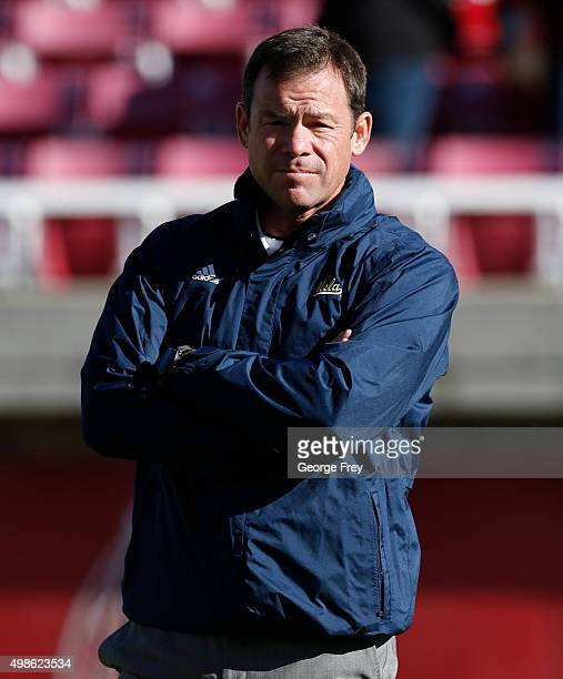 Head coach Jim Mora of the UCLA Bruins watches his players warmup before a game against the Utah Utes at a college football game at Rice Eccles...