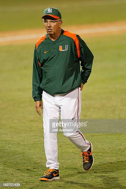 Head coach Jim Morris of the Miami Hurricanes walks back to the dugout after changing pitchers in the sixth inning against the Illinois State...