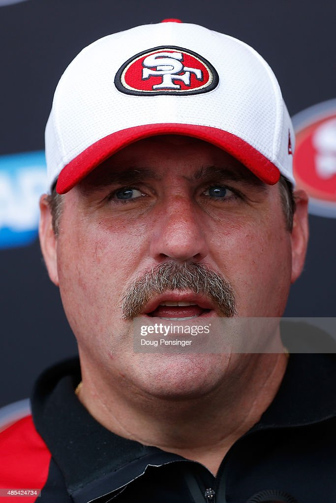 Head coach Jim Tomsula of the San Francisco 49ers talks to the media following a joint training session with the San Francisco 49ers and the Denver Broncos at the Denver Broncos Training Facility on August 27, 2015 in Englewood, Colorado.