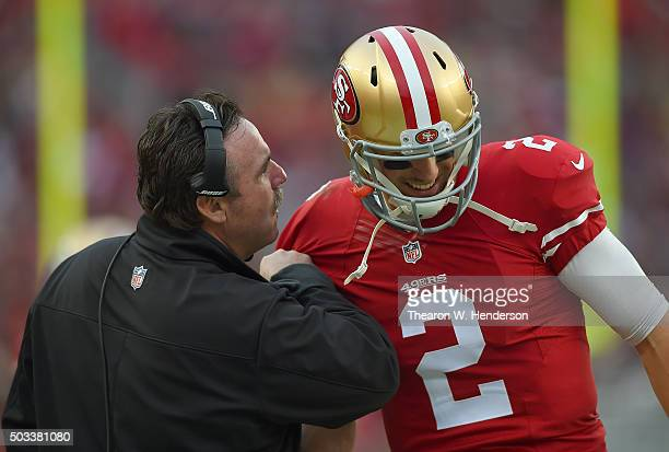 Head coach Jim Tomsula of the San Francisco 49ers talks with his quarterback Blaine Gabbert against the St Louis Rams during an NFL football game at...