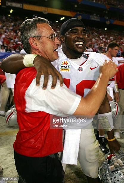 Head coach Jim Tressel hugs quarterback Troy Smith of the Ohio State Buckeyes after the Buckeyes defeated the Notre Dame Fighting Irish in the...