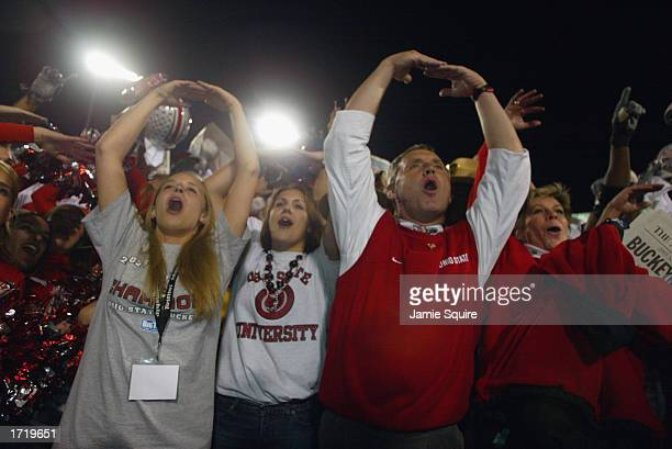 Head coach Jim Tressel of the Ohio State Buckeyes leads fans in the school song after the victory over the University of Miami Hurricanes in the...