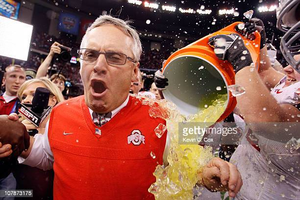 Head coach Jim Tressel of the Ohio State Buckeyes screams as Gatorade is dumped on him after the Buckeyes 3126 victory against the Arkansas...
