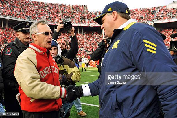 Head Coach Jim Tressel of the Ohio State Buckeyes shakes hands with Head Coach Rich Rodriguez after the Buckeyes defeated the Wolverines 37-7 at Ohio...