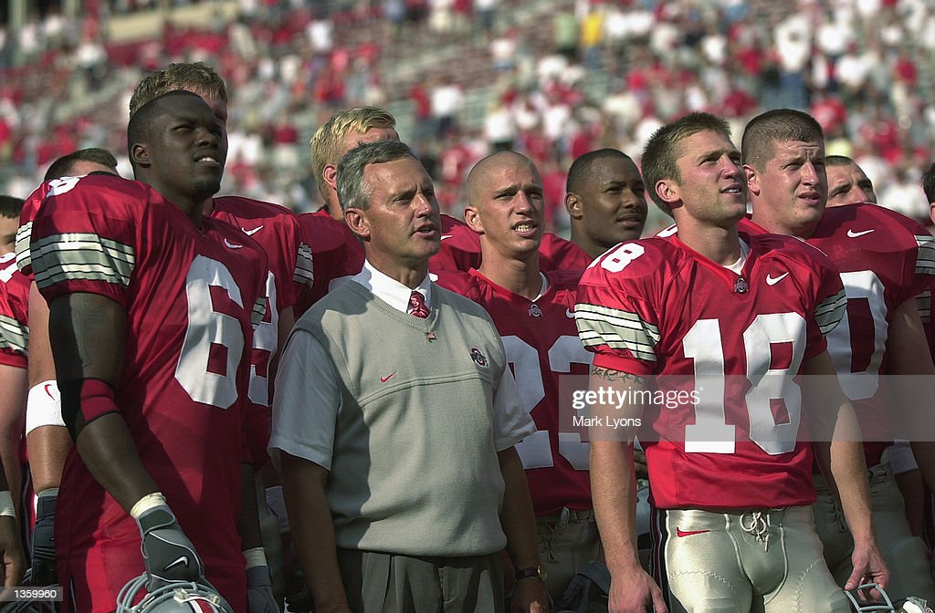 Head coach Jim Tressel of the Ohio State Buckeyes stands on the field with his team before the NCAA Pigskin Classic against the Texas Tech Red Raiders on August 24, 2002 at Ohio Stadium in Columbus, Ohio. Ohio State defeated Texas Tech 45-21.