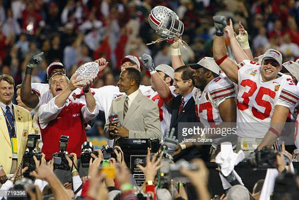 Head coach Jim Tressel raises the trophy as he and the Ohio State Buckeyes celebrate the victory over the University of Miami Hurricanes during the...