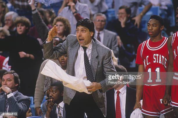 Head coach Jim Valvano of the North Carolina State Wolfpack gestures and yells to his team from the sidelines circa 1989