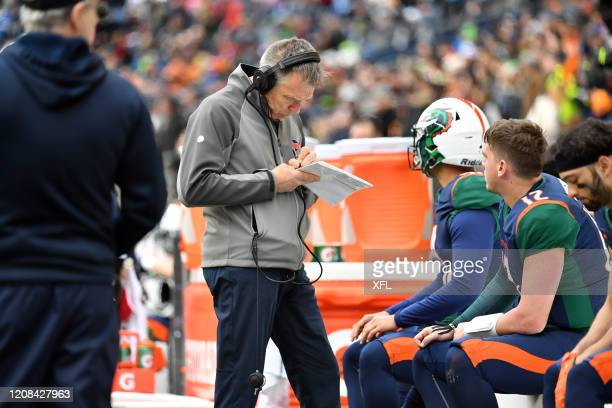 Head Coach Jim Zorn of the Seattle Dragons writes notes during the XFL game against the Dallas Renegades at CenturyLink Field on February 22, 2020 in...
