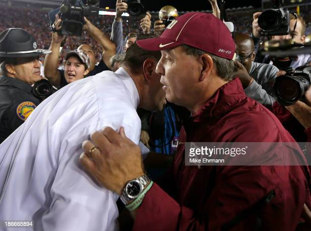 Head coach Jimbo Fisher of the Florida State Seminoles and head coach Al Golden of the Miami Hurricanes chake hands following a game at Doak Campbell...