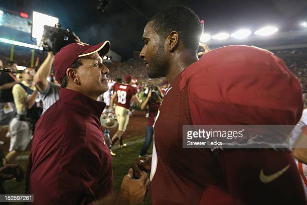Head coach Jimbo Fisher of the Florida State Seminoles celebrates with his quarterback EJ Manuel after defeating the Clemson Tigers 49-37 at Doak...