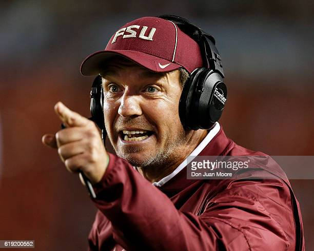 Head Coach Jimbo Fisher of the Florida State Seminoles disagree with officials on a call during the game against the Clemson Tigers at Doak Campbell...