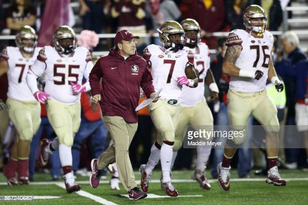 Head coach Jimbo Fisher of the Florida State Seminoles leads his team onto the field before their game against the Boston College Eagles at Alumni...